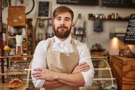 https://previews.123rf.com/images/ammentorp/ammentorp1512/ammentorp151200058/49228854-Portrait-of-young-man-wearing-apron-standing-with-his-arms-crossed-in-a-coffee-shop-Caucasian-man-wi-Stock-Photo.jpg